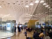Mobile boarding checks in for Vistara at Mumbai Intl Airport