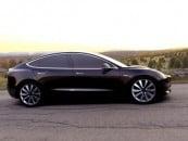 Tesla CEO Elon Musk unveils his latest possession, the Model 3